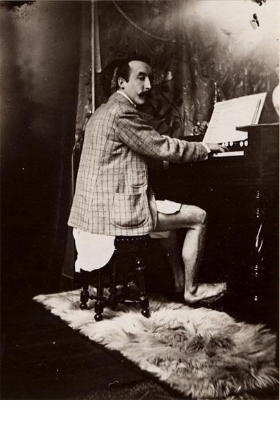 Paul Gauguin playing Mucha's harmonium, c. 1893