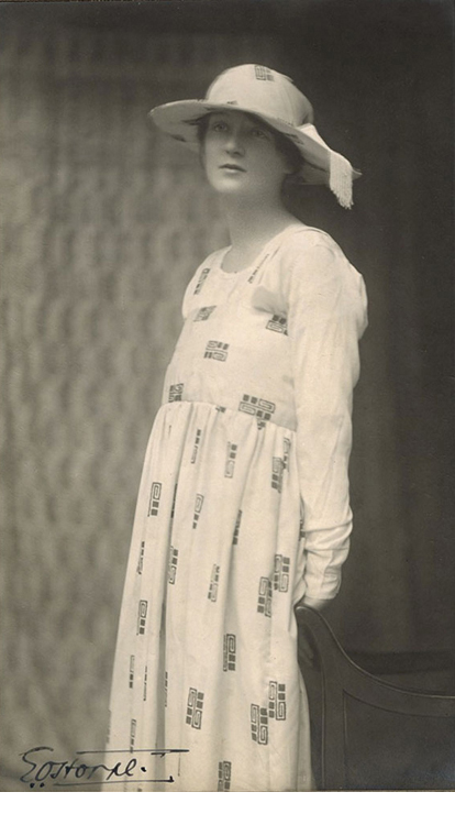 Woman in Reform Dress, gelatin silver print, early 1920's, signed in ink on recto, 8 x 4 3/4 inches on original studio double mount