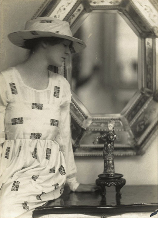 E.O. Hoppe, Woman in Reform Dress With Statue, gelatin silver print, early 1920's
